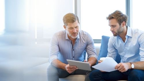Two men discussing commercial and business loan