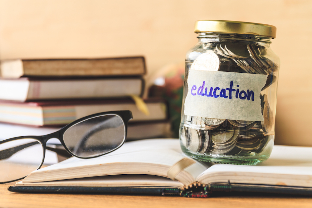 Jar of coins with label 'education'