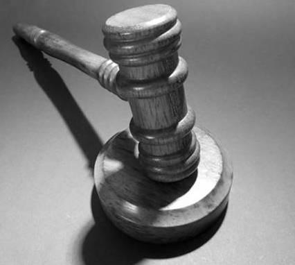Greyscale image of wooden gavel